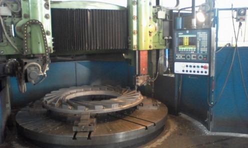Tornitura CNC anello palettato compressore diametro 1800 mm su tornio verticale